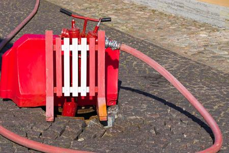 water supply: fire fighting equipment on the city street in a water intake zone from an underground water supply system closeup Stock Photo