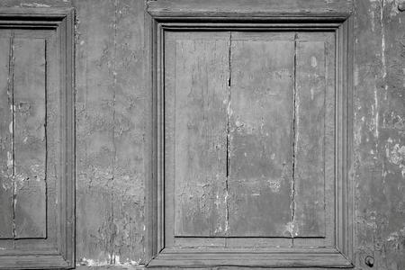 grooved: vintage texture of an old wooden board of doors or gate closeup for an ancient background or for wallpaper