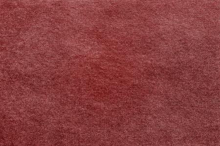 red wallpaper: rough texture of red paper or fabric for a background or for wallpaper with empty space