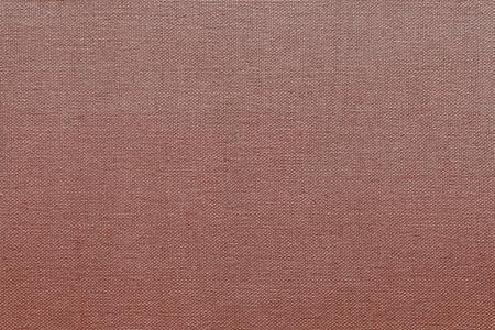 red wallpaper: textural weave from of threads fabric of pale red color for textile background or for grid wallpaper Stock Photo