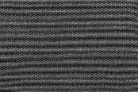 fluted: surface of fluted fabric or textile material for the textured wallpaper and for a background of monochrome black color Stock Photo