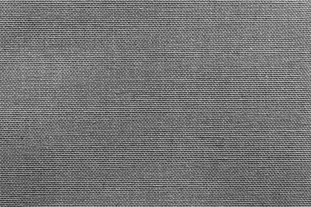 fluted: surface of fluted fabric or textile material for the textured wallpaper and for a background of monochrome gray color Stock Photo