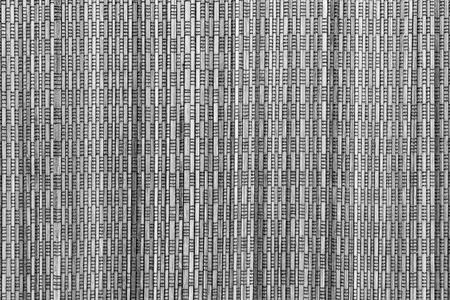 speckled wood: abstract vertical pattern of a cover from wooden straws of gray color for the textured background and for wallpaper