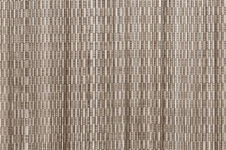 speckle: abstract vertical pattern of a cover from wooden straws for the textured background and for wallpaper of sepia color Stock Photo
