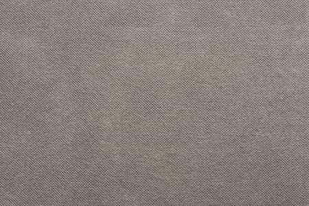 grooved: the grooved textured design of fabric with pile for the abstract background and for wallpaper of beige color
