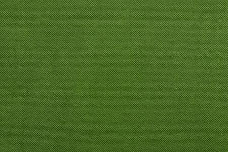 grooved: the grooved textured design of fabric with pile for the abstract background and for wallpaper of green color