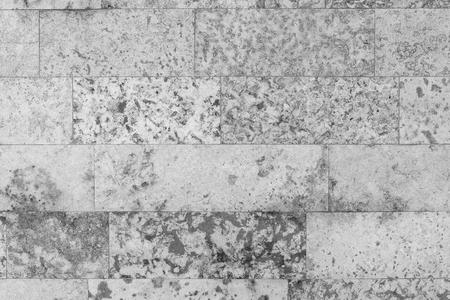 spotty: abstract spotty texture of an old stone wall for speckled background and for wallpaper of monochrome tone