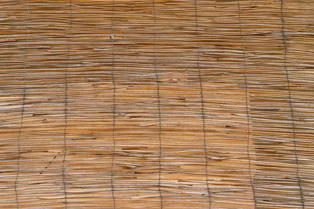 fluted: uneven corrugated or fluted texture from old wooden rods for an abstract background and for wallpaper