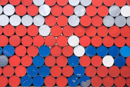 the textured abstract background from the round bottoms of old iron barrels of red blue white color