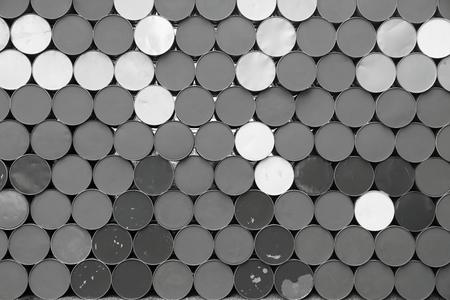 bottoms: the textured abstract background from the round bottoms of old iron barrels of monochrome gray tone