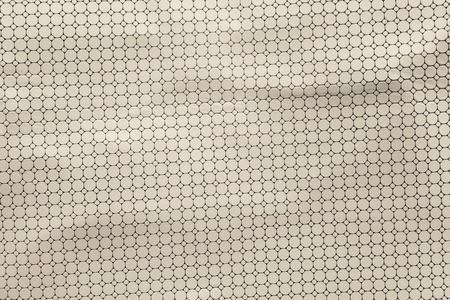 pale colours: texture of the punched leather of pale beige color for a background or for perforated wallpaper