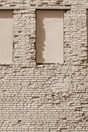 niches: the old textured brick surface of beige color for a background and window niches on a wall Stock Photo