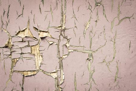 pale color: old texture of a peeling of the wooden board painted in the pale color for abstract background Stock Photo