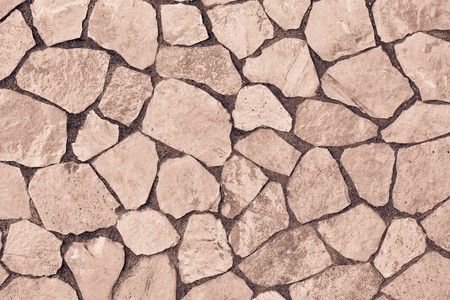 stone floor: abstract texture of a facing stone of brown color for a background or for wallpaper
