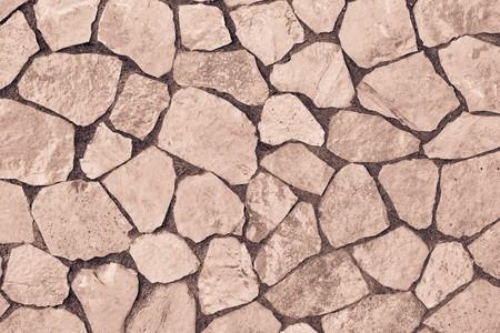 piso piedra: Textura abstracta de un revestimiento de piedra del color marrón para un fondo o para el papel pintado