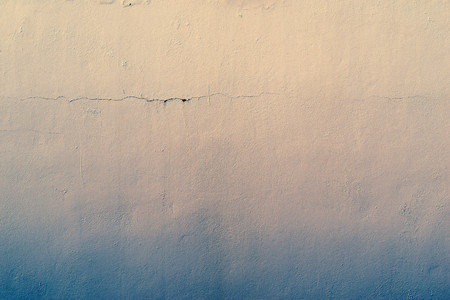 tonality: the abstract textured background of an old surface of the plastered wall of a motley color tonality