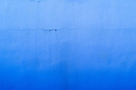 tonality: the abstract textured background of an old surface of the plastered wall of a motley blue color tonality