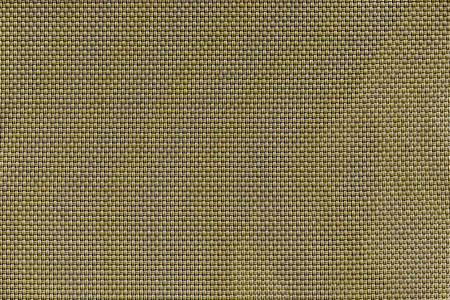 corrugated texture of rough fabric of khaki color with an interlacing of threads for a woven