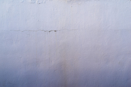 tonality: the abstract textured background of an old surface of the plastered wall of a motley violet color tonality Stock Photo