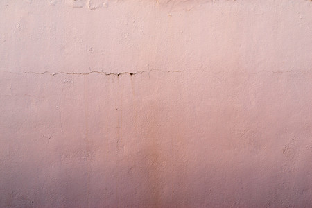 tonality: the abstract textured background of an old surface of the plastered wall of a motley pink color tonality Stock Photo