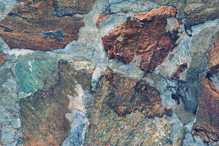 channeled: stone mosaic of a floor or wall closeup for an abstract background and for wallpaper of motley color Stock Photo