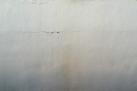 tonality: the abstract textured background of an old surface of the plastered wall of a motley silvery color tonality