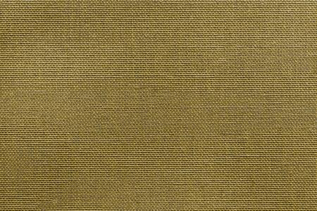 Stock Photo - the textured background or wallpaper from rough fabric of khaki color and a blank space