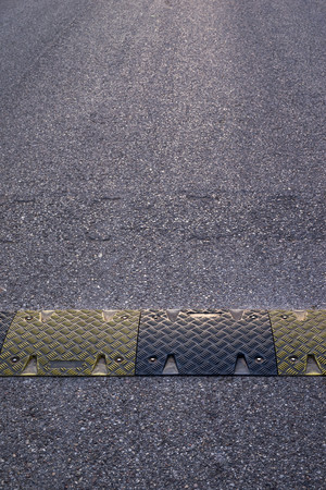 background texture of the asphalted road or the highway and a hump closeup for reduction in the rate of the movement of vehicles