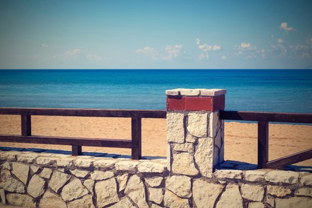 architecture of the stone embankment or seafront with a fence closeup in retro style Stock Photo