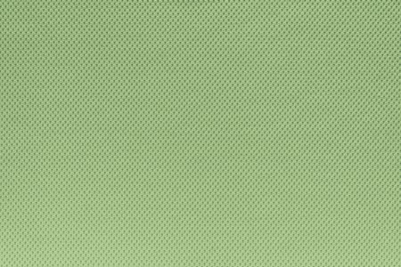 background and texture of cotton fabric of green color