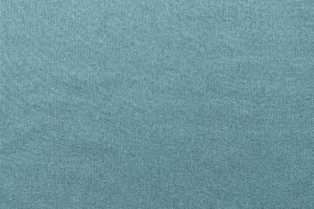 background and vertical corrugated texture of cotton fabric of turquoise color