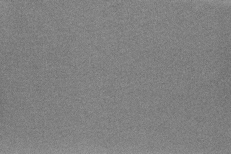 grey pattern: abstract speckled texture and background of textile material or fabric of gray color