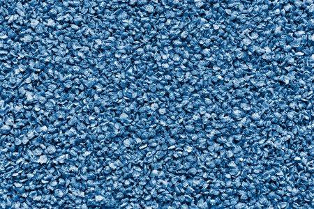 青い色のフレークをひき割り穀物から抽象的なテクスチャ背景