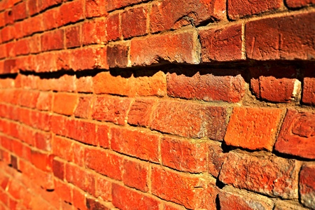 red brick wall with focus in the foreground Фото со стока