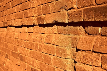brick wall with focus in the foreground of bright color sepia Фото со стока