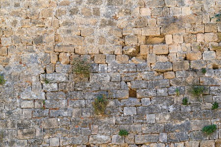 old stone wall of ancient fortress for a background with vintage texture Stock Photo