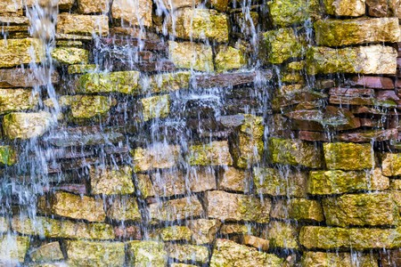 wet stone brick wall with water splashes for the abstract textured background Reklamní fotografie