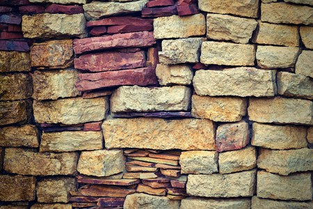 background texture: the abstract textured background of an old stone brick wall