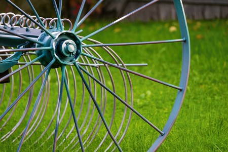 abstract big iron wheel of the ancient farm vehicle or unit closeup