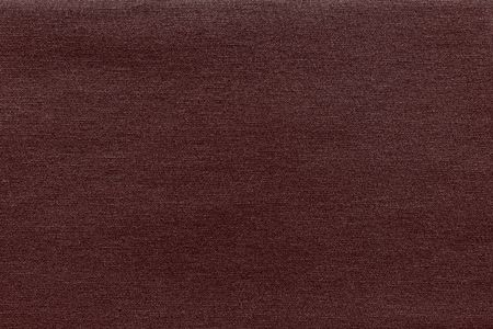 Textured background of fabric or textile material of claret color Stock Photo