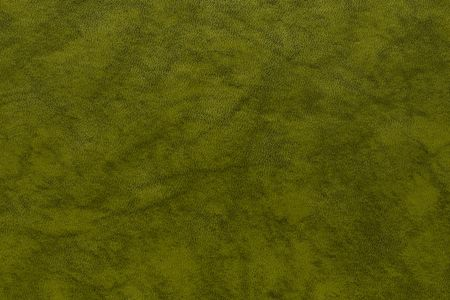 speckled abstract texture of paper or the marble textured background of khaki color