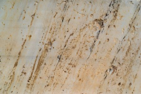 the flat and rough textured stone surface for an abstract background and for wallpaper