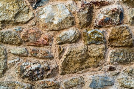 the abstract textured surface of an old stone wall for backgrounds and for wallpaper Stock Photo