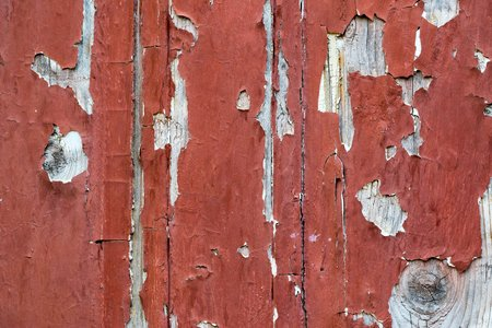 abstract texture of the old peeled paint on a surface of wooden boards closeup