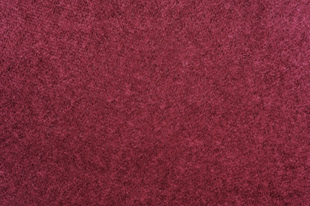 abstract fluffy fleecy texture of fabric or textile material of claret color for a background or for wallpaper Stock Photo