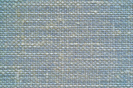 illustration of abstract speckled texture of fabric or textile material of blue gray color for a background or for desktop wallpaper
