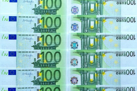 abstract background collage of money and currency or banknotes of hundred euros closeup