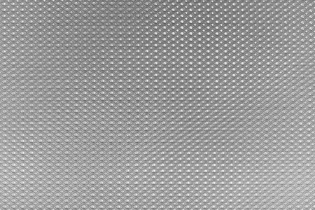abstract silvery gray background and wallpaper with imitation of texture of plastic or fabric with the convex grained pattern