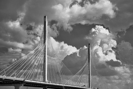 the big and modern cable-stayed bridge in St. Petersburg against the background of the cloudy sky monochrome tone
