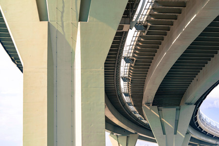 part of an engineering construction or structure of the big automobile bridge or viaduct with a reinforced concrete march and support closeup Archivio Fotografico